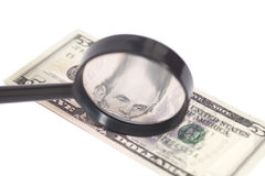 Five dollar bill with a magnifying glass Stock Image