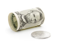 Five dollar bill and silver coin Stock Image