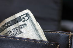 Five dollar bill in wallet Royalty Free Stock Photos