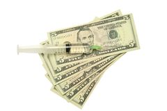 Five dollar bills and syringe Stock Images