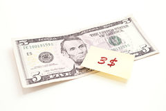 Five dollar with post-it note. World financial crisis Stock Image