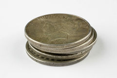 Five dollars. Five silver dollars royalty free stock photography