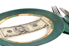 Five Dollars on Empty Plate. Five dollar bill on an empty plate Royalty Free Stock Photo
