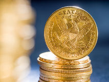 Five Dollars gold coins Stock Photo