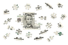 Five dollars jigsaw. There is a banknote jigsaw in the photo. This banknote is a US five dollars Royalty Free Stock Photography