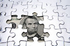 Five dollars & puzzle. U.S. five dollar banknote and jigsaw puzzle Royalty Free Stock Photo