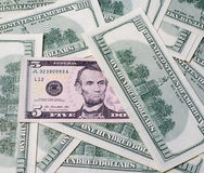 Five dollars in the United States of America as a background Royalty Free Stock Images