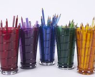 Five Drinking Glasses Holding Coloring Pencils Royalty Free Stock Photography