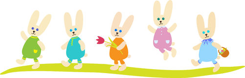 Five Easter Bunnies. In clothes of different colors, one of them holds a basket, and the other carries a flower Royalty Free Stock Photography