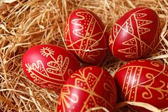 Five easter eggs. Five traditional easter eggs in straw Royalty Free Stock Photography