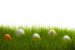 Five easter Eggs on green grass Stock Photos