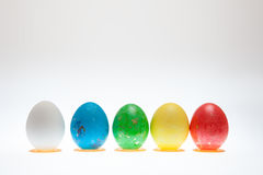 Five Easter eggs on pedestals on a white background Royalty Free Stock Images