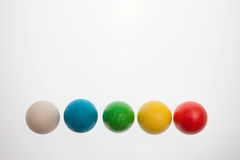 Five Easter eggs on pedestals on a white background stock images