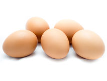 Five eggs on white background Stock Photo