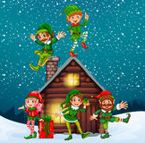 Five elves at the wood cabin on christmas night Royalty Free Stock Photography
