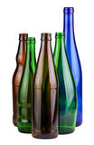 Five empty bottles Stock Images