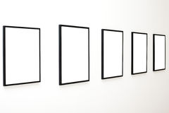 Five empty frames on white wall exhibition Stock Images