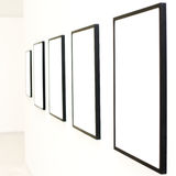 Five empty frames on white wall exhibition. In Museum royalty free stock photo