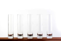 Five empty glasses Stock Images