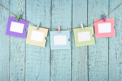 Five empty photo frames hanging with clothespins Stock Photography