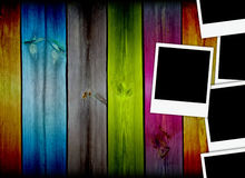 Five Empty Polaroids on Colorful Wooden Background. Three empty polaroids on multi-colored wooden planks background. A great frame for your images. Please visit Royalty Free Stock Images