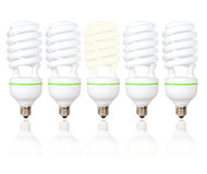 Five energy saving light bulbs with green lines Royalty Free Stock Images