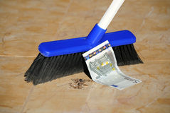 Five Euro Banknote and a Broom Stock Photo