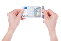 Five Euro banknote in female hands Stock Images