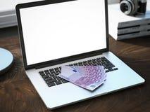 Five euro bills on modern laptop Royalty Free Stock Photo