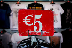 Five euro. Selling shirts for five euros royalty free stock photography