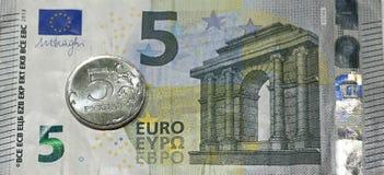 Five euros, five rubles. Stock Photo