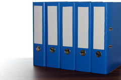 Five file folders in a row Stock Photo