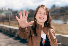 Five fingers by beautiful young woman outdoor Stock Images