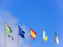 Five flags isolated on blue sky Royalty Free Stock Images