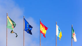 Five flags isolated on blue sky Stock Photo