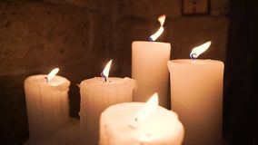 Five flickering candles on the black background. Many burning candles. Candles new year. Valentine candle lights. Valentine`s day stock video footage