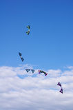Five flying kites in the cloudy sky Stock Photography