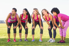 Five focused runners supporting breast cancer marathon Stock Photos