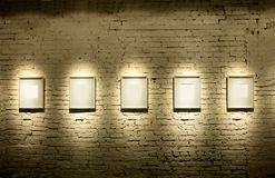 Five frames. On brick wall Royalty Free Stock Image