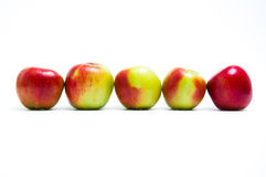 Five fresh apples in a row Stock Image