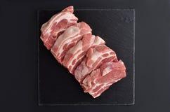 Five fresh raw boneless pork shoulder butt slices Stock Photo
