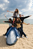 Five friends on the boat. Group of five smiling teenagers on the board of a boat Royalty Free Stock Images
