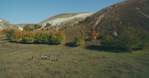 Five friends have a trip together at nature taking video with drone aerial view. stock video footage