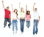 Five friends jumping and smiling Stock Photography