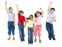 Five friends jumping and smiling Royalty Free Stock Images