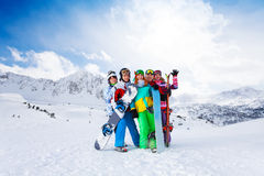 Five friends standing with snowboards Stock Images