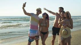 Five friends taking a selfie on sandy beach stock video