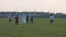 Five friends are trying to launch a homemade cardboard rocket into the air. They start the engines and run to the sides. The rocke. T explodes scattering stock video