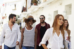 Five friends on vacation walking through town, Ibiza, Spain Stock Photos