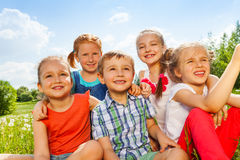 Five funny kids on a meadow Royalty Free Stock Images
